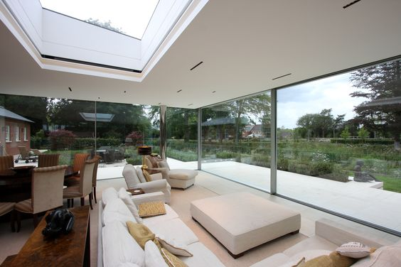 Interior view looking out onto the garden through the floor-to-ceiling  sliding glass doors | Great Windows | Pinterest | Glass extension, Glass  doors and ...
