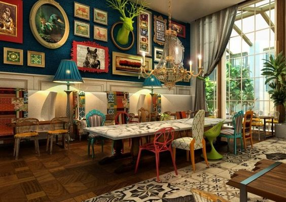 well this is my dream kitchen, right down to the mismatched chairs and green bust.