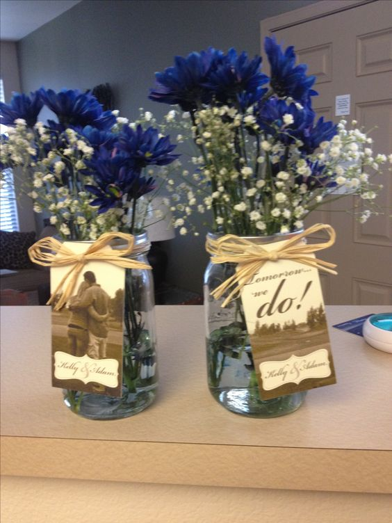 Adorable small centerpieces for the rehearsal dinner...mason jars, twine, baby's breath, and daisies.