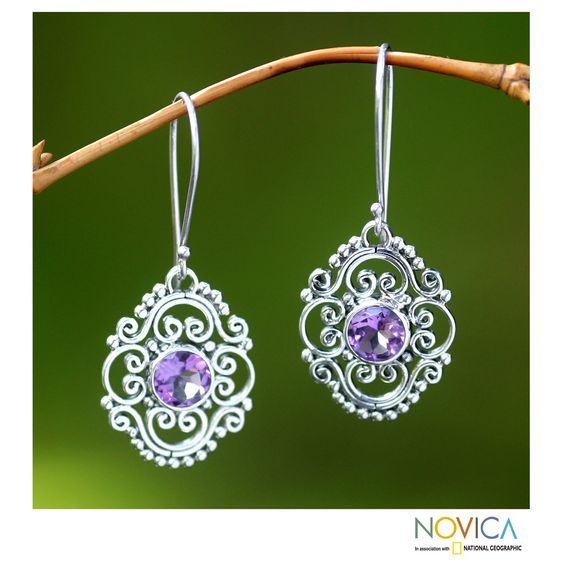 Amethysts center ornate mosaics of Indonesian elegance in earrings by Buana. He crafts the earrings by hand with sterling silver.