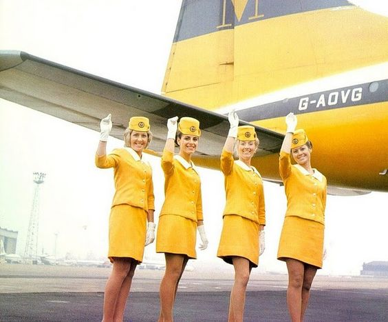 Vintage Monarch Airlines uniforms.. they look like easter chicks...