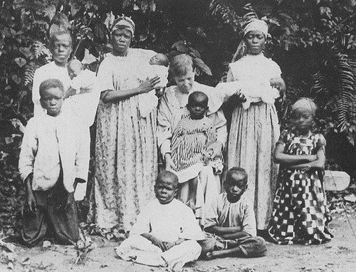 Mary Slessor (seated) was a Scottish missionary in eastern Nigeria. She lived for a long time among the Efik people in Calabar where she successfully fought against the killing of...: