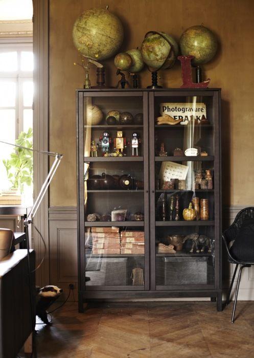 Globes, library cabinet, herringbone wood floors