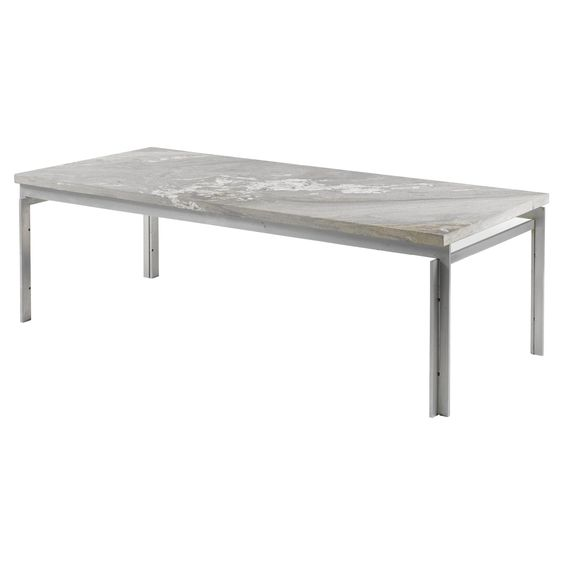POUL KJÆRHOLM 'PK 57': A COFFEE TABLE manufactured by E. Kold Christensen, brushed steel and marble manufacturer's stamp 44.5cm. high by 150cm. long by 65cm. wide; 1ft 5 1/2 in., 4ft 11in., 2ft 1 1/2 in. designed 1957