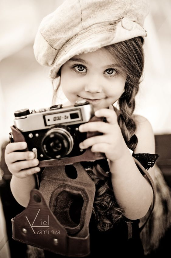 Young Photographer. Adorable <3 :)