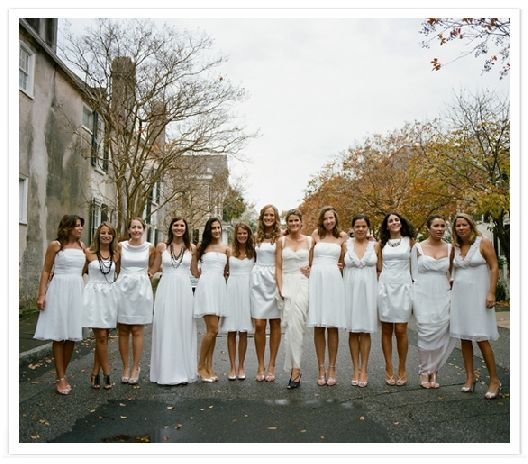 Can you spot the bride? It took us a couple of looks but we found her! For the not so attention seeking bride on her big day, white bridesmaids dresses are the way to go!