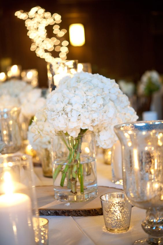 white hydrangeas + lots of candles low center piece ideas.