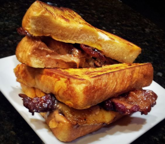 Viva La Sammie - French Toast Slices stuffed with Caramelized Brown Sugar Bananas, Candied Whiskey Bacon, and Peanut Butter