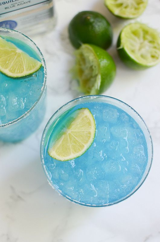Blue Margaritas - tequila, triple sec, blue curacao, and lime juice! Perfect for Cinco de Mayo!