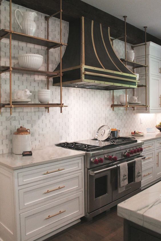 Wolf Stove makes a statement with the gorgeous hood in this kitchen!