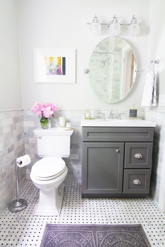 Small Bathrooms rug and artwork really add so much. And of course the fresh flowers. I don't know why I haven't settled on artwork for our bathroom below yet. Such a great way to add personality and color: