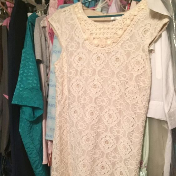 Only wore once or twice. Lace stress size 10. Button missing but has extra to be put back on. Coach Dresses