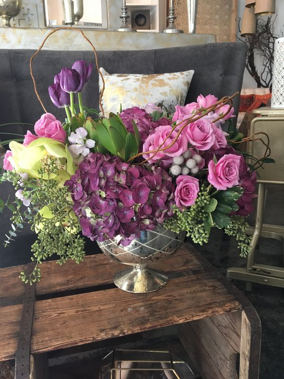 A gorgeous mix of spring purples in a champagne mercury vase.