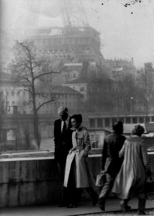 Audrety Hepburn and Hubert de Givenchy walking in front of the Eiffel Tower.: