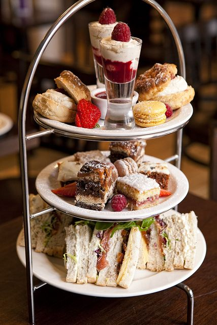 Afternoon tea wedding reception snacks <3 Cake stands filled with scones, heart shaped finger sandwiches, french fancies, macarons, gooey brownies, lavender shortbread and strawberry tarts. Mountains of fresh strawberries and raspberries. Cups and saucers of Earl grey tea and English breakfast with glasses of pimms :)