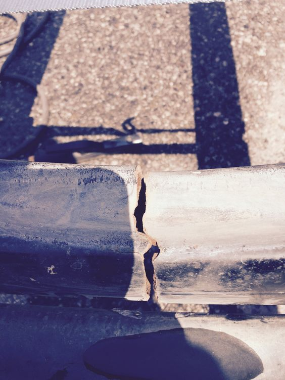 Close-up of crack in boat frame prior to welding repairs.