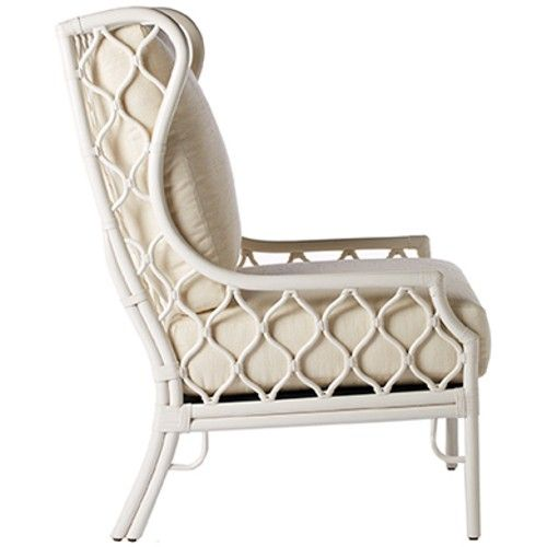 Generously proportioned wing back rattan pole chair creates airy textured décor with Berber inspired lattice. Leather wrapped rattan pole, rice fabric upholstery.  As seen in Traditional Home November/December 2014 Issue. **refer to photo 2**