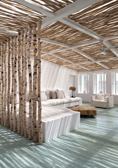White light-filtered living area with birch room divider. Interior Design Photography by Matheus Photo