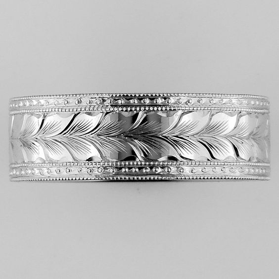 Hand engraved platinum band (by artist Harry Caldwell at Greenlake Jewelry Works in Seattle, WA