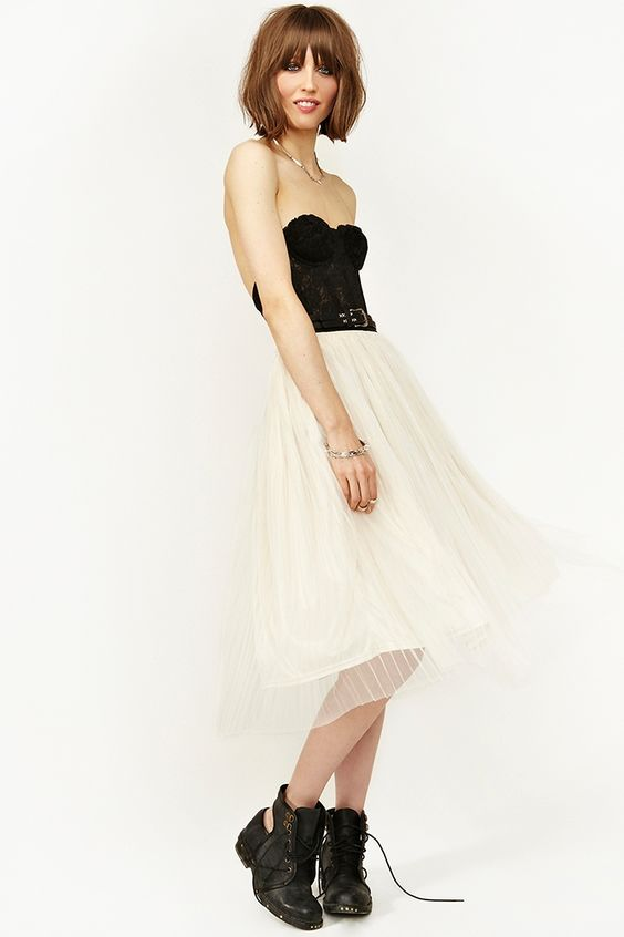 Last Dance Skirt   $33.60 Was 48.00 Sale  Twirl around the dance floor in this cream tulle midi skirt featuring a high waist and pleated detailing. Black stretch panel, fully lined. Looks amazing with a bustier and crystal ear cuffs!  http://www.nastygal.com/sale/last-dance-skirt#