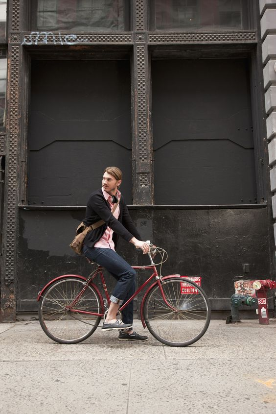 Caucasian man riding bicycle on city sidewalk by Gable Denims - Photo 91190227 - 500px