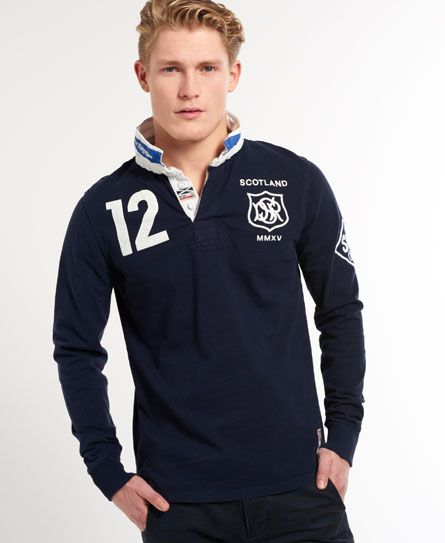 Superdry men's Valiant Rugby shirt. With design inspiration taken from vintage rugby, the Valiant shirt pays homage to the classic international rugby spirit. Featuring distressed number prints on the back and chest, printed flag emblem under the collar, embroidered chest logo and embroidered sleeve motif on a heavyweight vintage wash fabric. #Superdry #Valiant #Sport