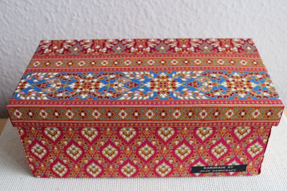 Handmade box , covered with fabric. This box here has been thoughtfully put together using recycled materials. An excellent choice for an unique present!