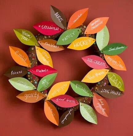 "Thanksgiving gratitude. Wrap 12"" styrofoam wreath w/fabric secured w/ball-head pins. Cut card stock leaves, creasing each to add dimension. Hang w/loop of string."