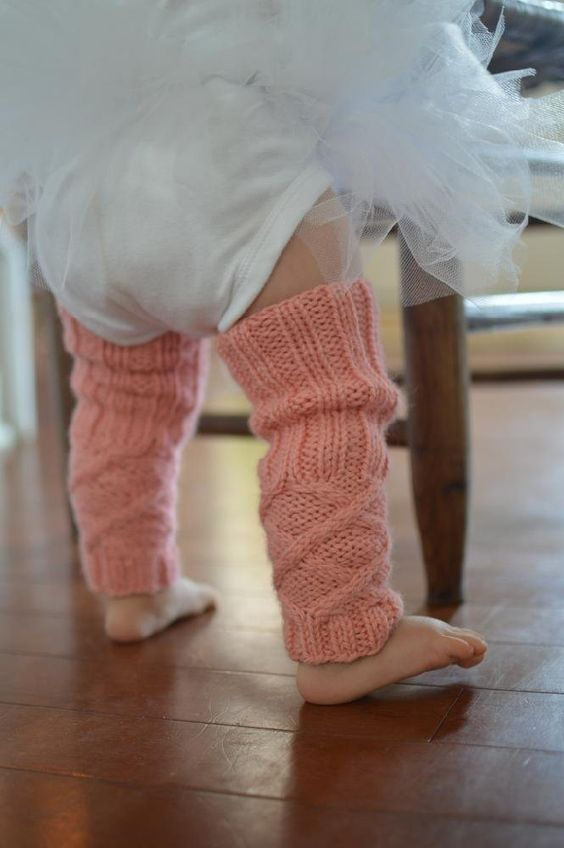 Cute cabled legwarmers for babys and toddlers that comes in two sizes - find the knitting pattern on LoveKnitting!
