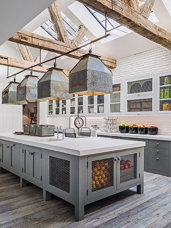 Industrial farmhouse kitchen with grey cabinets, galvanized industrial pendants over island, and wood beams. #industrialfarmhouse
