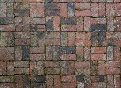 Old factory brick used in alternating pattern patio floor Stock Photo