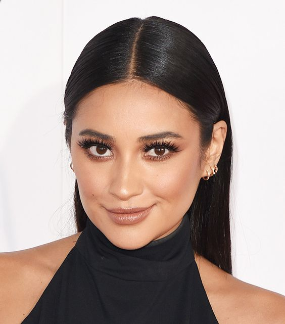 From Shay Mitchell's rust eye makeup to Priyanka Chopra's bergundy lup, these 10 celeb NYE looks are absolutely *stunning.*: