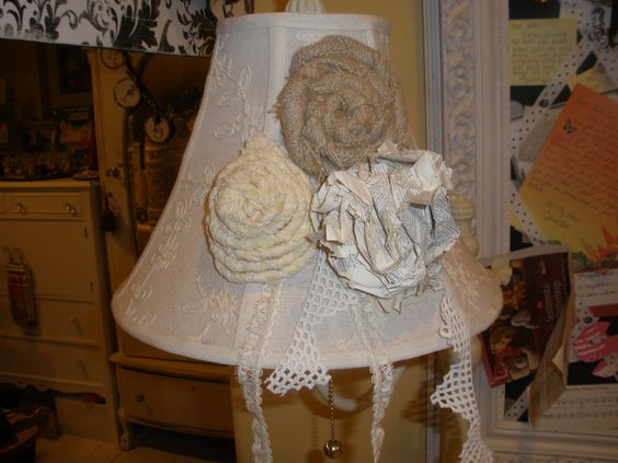 Vintage lace, vintage Bible page and burlap turned flowers I added on a free lamp given to me - in my craft studio.