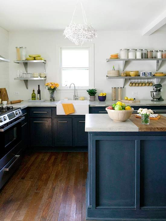 Inky blue cabinets add a pop of color to this classic kitchen. More colorful kitchen islands: http://www.bhg.com/kitchen/island/colorful-kitchen-islands/?socsrc=bhgpin050312BlueIsland