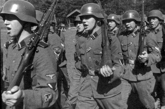 Finnish Waffen-SS on the march. This is a good shot of the lion patch on their sleeves.