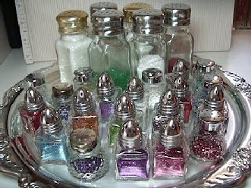 Use salt shakers to sort all your glitter