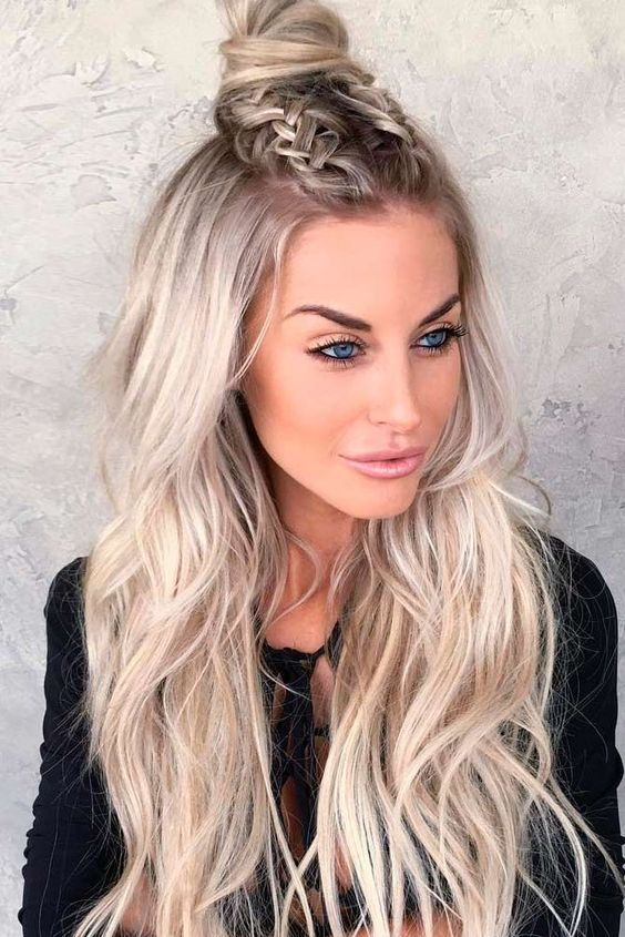 A Half Updo With Two Braids On Top A Top Knot And Wavy Hair Down Is A Whimsy Hairstyle For Long Hair Trends Down Hairstyles For Long Hair Braids For Long