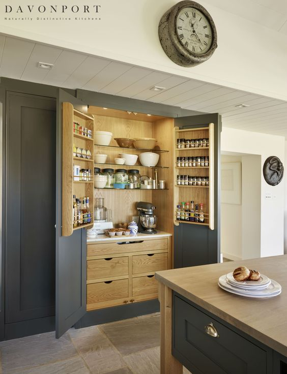 The free standing pantry is a classic combination of hand painted dark grey and oak. Our client is a keen chef who particularly enjoys baking, The marble shelf provides a cool space to keep baked goods whilst the drawers, spice racks and shelving offers ample space to store crucial ingredients and appliances. By storing items such as the KitchenAid in the pantry, worktop space is left clear.