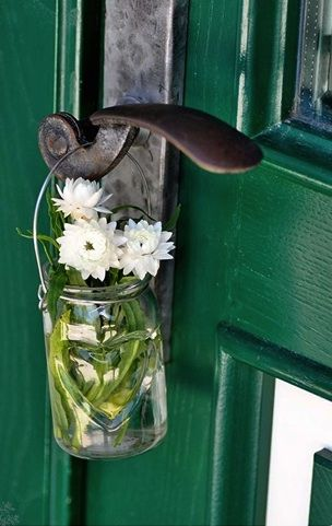 hanging a jar of herbs or flowers on a door handle might make things smell lovely every time you open the door