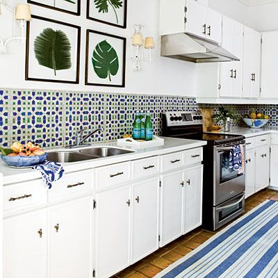 Mosaic tiles are a staple of island style. Bump up the Jamaican vibe a notch by using ocean blue and palm green hues throughout. Bamboo accessories such as the sconces and cabinet pulls add pops of island-inspired sophistication.