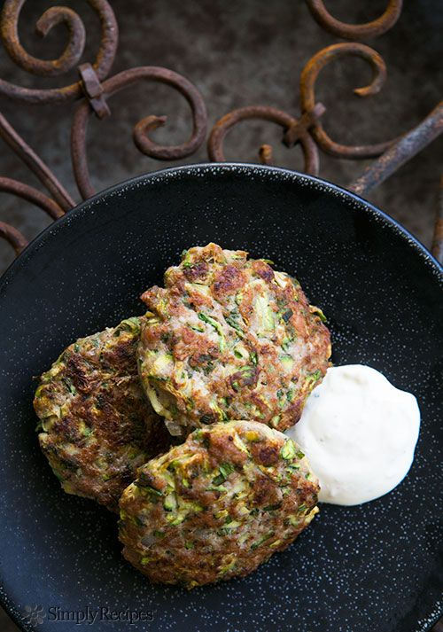 Spicy Turkey and Zucchini Burger ~ Turkey burger patties with grated zucchini, herbs, cumin, and cayenne, served with lemony sour cream sauce. ~ SimplyRecipes.com