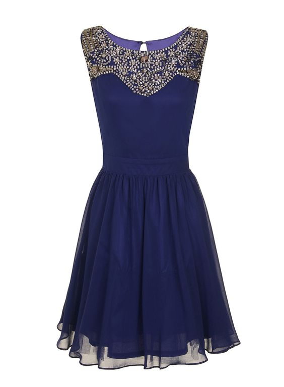 A classic party dress with a heavily embellishment a key colour for this season.