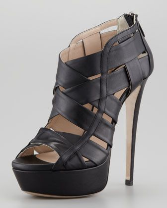 My personal favorite shoe for Fall 13.  Pre-Order now on Neimanmarcus.com while they still have your size...Halle Caged Platform Bootie, Black by Ruthie Davis at Neiman Marcus.