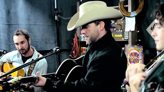 "Aaron Watson ""July in Cheyenne"", via YouTube. amazing song written in tribute to Lane Frost for his mother...get chills everytime I listen to it."