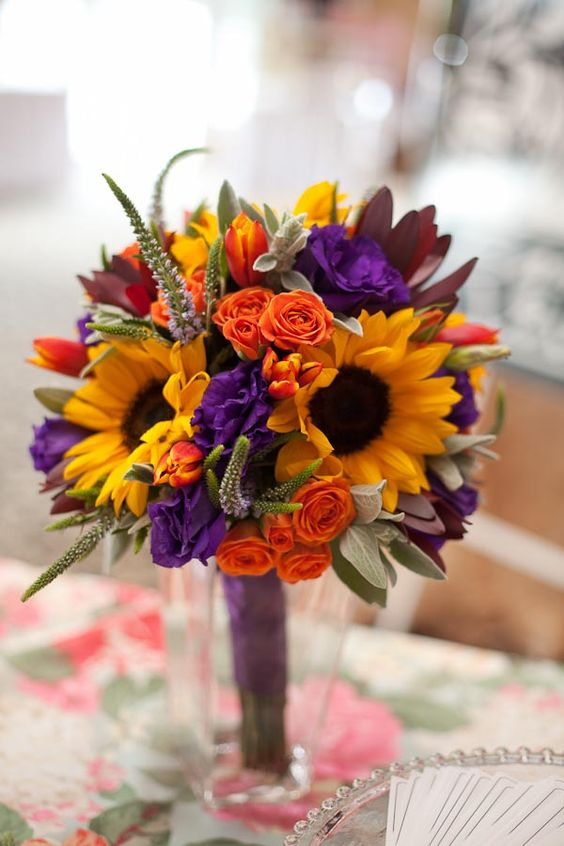 http://photosbyyvonne.net/  Photos by Yvonne: Toledo, OH Wedding Photographer,  purple , yellow & orange bouquet  designed by Ann Strickland of Bartz Viviano. Sunflowers