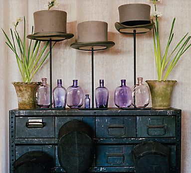 Love the top hats with the vintage cabinet and blown purple glass!