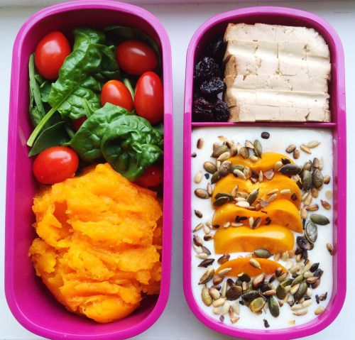 Hers; vegan bento lunch. Smoked tofu with mashed queen squash, spinach and baby plum tomatoes, followed by almond soy yoghurt with persimmon, toasted seeds and raisins.