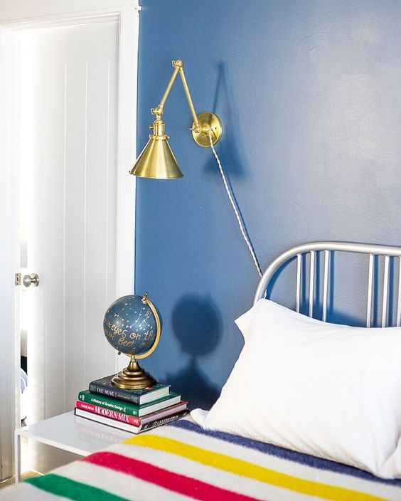 Catch the makeover of the master bedroom at the lake house over at the blog. It was a week full of improvements! Sconces by @schoolhouse // paint is Van Deusen blue by @benjaminmoore // blanket by @hudsonsbay #33aboardwalk #beforeandafter http://ift.tt/1J