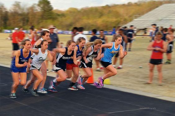 Beginning of the women's one mile run.  Cleveland, Tennessee - Blue Raiders High School, Invitational Track Meet.   NorkusPhoto