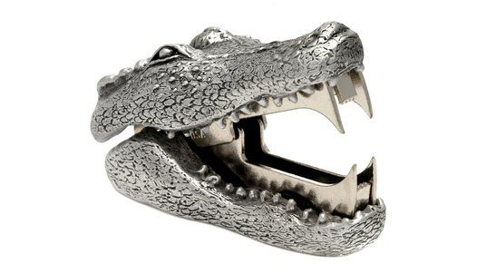 Alligator Staple remover. Add some fun to the mundane task of staple removing with these ferociously toothy beasts. Made of solid pewter, they're a great corporate gift. $78